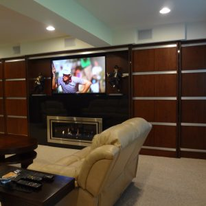 The large screen TV and firebox are programmed and controlled with a hand-held remote. The energy efficient firebox serves as a supplemental heat source that stops heat loss and redirects it into the room. The tiered soffits hade concealed surround sound for speakers.