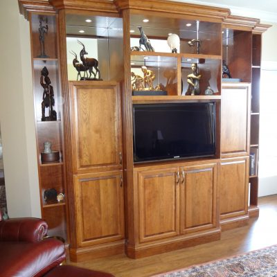 Custom cabinetry balances open display and closed storage to match the specific needs of the client.